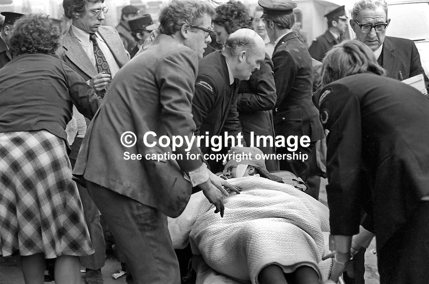 Injured woman stretchered away from scene, Provisional IRA explosion, North Streeet Arcade, Belfast, N Ireland, 13th January 1976, in which two civilians and two Provisional IRA members died when the bomb exploded prematurely. All of those who died were Roman Catholics. 197601130037c<br />