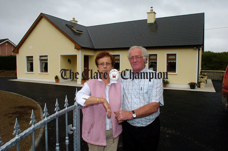 Moira and Denis Moroney outside their new home at Scariff road Tuamgraney. Photograph   by John Kelly.