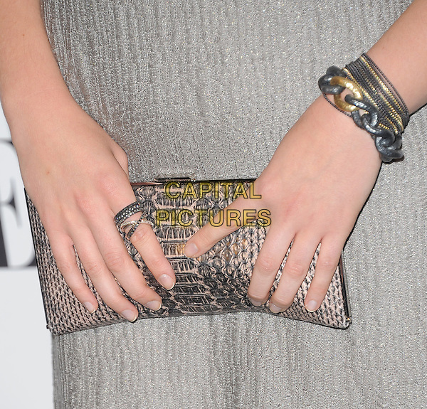 Elizabeth Olsen's bag.18th Annual ELLE Women in Hollywood celebration held at The Four Seasons in Beverly Hills, California, USA..October 17th, 2011.hands snakeskin bracelets ring silver gold chain grey gray clutch bag   .CAP/RKE/DVS.©DVS/RockinExposures/Capital Pictures.