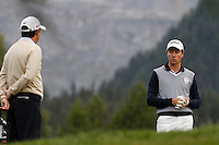 Peter Lawrie (IRL) Brett Rumford (AUS) on the 12th during the 1st day of the Omega European Masters, Crans-Sur-Sierre, Crans Montana, Switzerland..Picture: Golffile/Fran Caffrey..