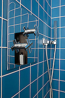 "The taps and shower in the wet room are the ""Noox"" design by Zazzeri and the sky-blue glass tiles are by Salverbat"
