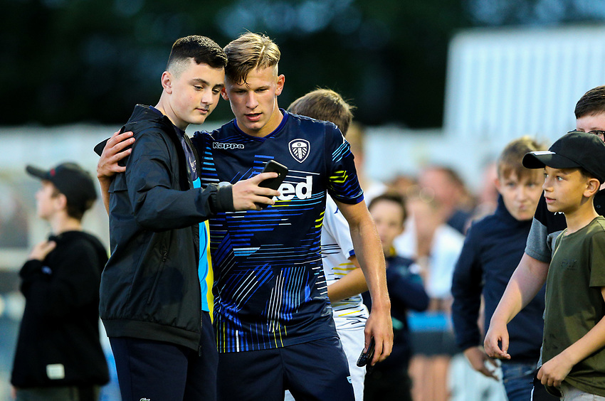 Leeds United's Mateusz Bogusz poses for a picture with a young fan after the match<br /> <br /> Photographer Alex Dodd/CameraSport<br /> <br /> Football Pre-Season Friendly - Guiseley v Leeds United - Thursday July 11th 2019 - Nethermoor Park - Guiseley<br /> <br /> World Copyright © 2019 CameraSport. All rights reserved. 43 Linden Ave. Countesthorpe. Leicester. England. LE8 5PG - Tel: +44 (0) 116 277 4147 - admin@camerasport.com - www.camerasport.com