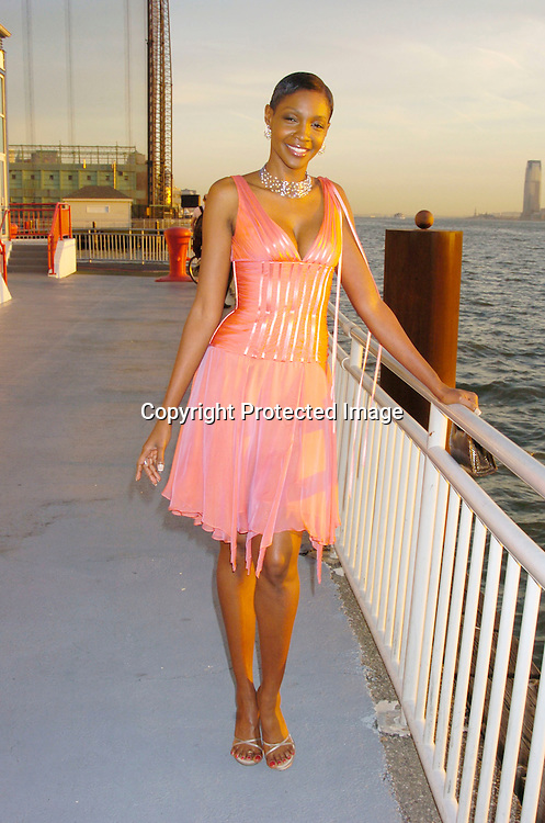 Roshumba Williams in Carmen Marc Valvo dress..at the Arthur Ashe Institute for Urban Health Sportsball 2004 on April 29, 2004 at PIer Sixty at Chelsea PIers. ..People were told to wear Blcak tie and sneakers. ..Photo by Robin Platzer, Twin Images