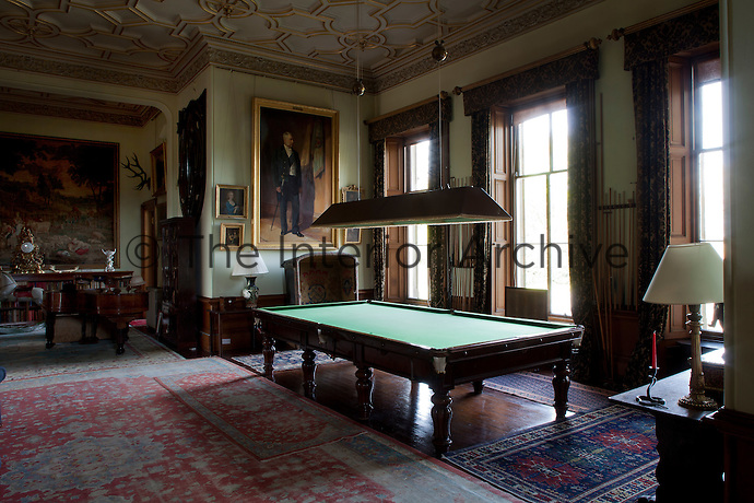 Despite its faded carpets, the billiard room/inner hall still retains the air of a grand Victorian room