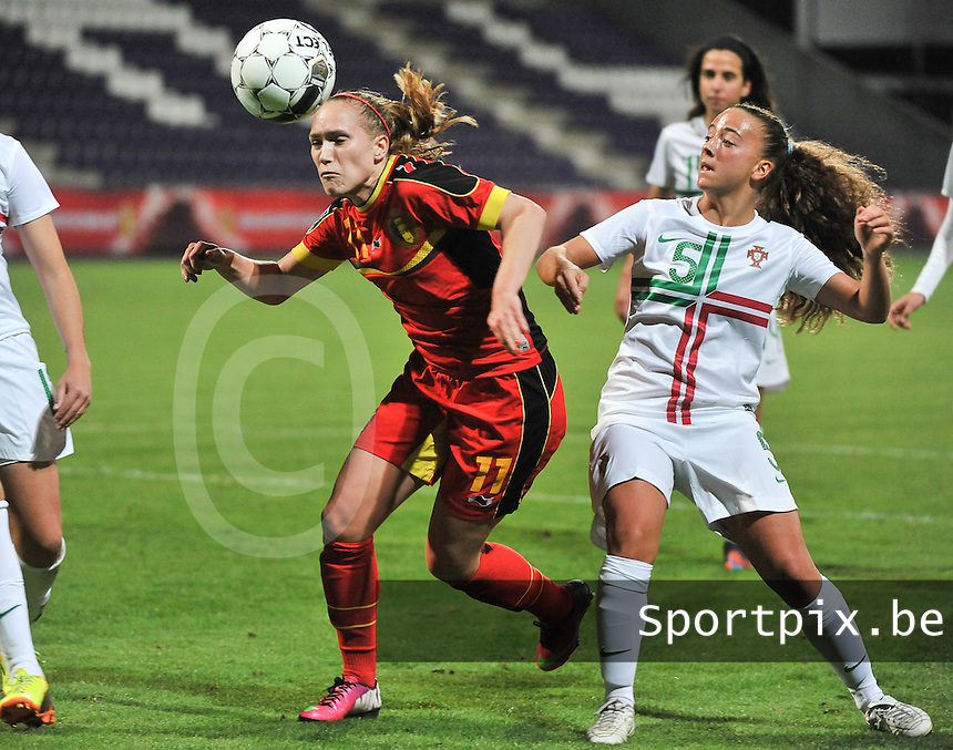 20131031 - ANTWERPEN , BELGIUM : Belgian Janice Cayman (11) pictured in a duel with the Portugese Matilde Fidalgo (right) during the female soccer match between Belgium and Portugal , on the fourth matchday in group 5 of the UEFA qualifying round to the FIFA Women World Cup in Canada 2015 at Het Kiel stadium , Antwerp . Thursday 31st October 2013. PHOTO DAVID CATRY