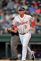 Manager Darren Fenster (3) of the Greenville Drive runs to his position along third base in a game against the Greensboro Grasshoppers on Wednesday, August 26, 2015, at Fluor Field at the West End in Greenville, South Carolina. Greenville won, 7-0. (Tom Priddy/Four Seam Images)