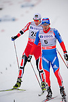 HOLMENKOLLEN, OSLO, NORWAY - March 16: (R-L) Ilia Chernousov of Russia (RUS) finishes 3rd place in front of 4th place Petter Eliassen of Norway (NOR) during the Men 50 km mass start, free technique, at the FIS Cross Country World Cup on March 16, 2013 in Oslo, Norway. (Photo by Dirk Markgraf)