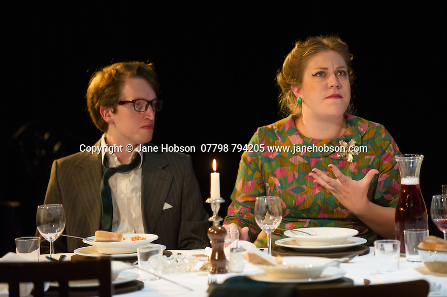 London, UK. 18.07.2014. Mountview Academy of Theatre Arts presents SATURDAY, SUNDAY, MONDAY by Eduardo de Filippo, the English adaptation by Keith Waterhouse & Willis Hall, directed by Michael Howcroft, at the Unicorn Theatre, as part of the Postgraduate Season 2014. Picture shows:  James Ruskin (Dr Cefercola), Sophie Napleton (Aunt Meme). Photograph © Jane Hobson.