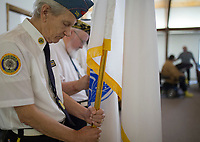 NWA Democrat-Gazette/CHARLIE KAIJO Hospital Corpsman Bill Berry of the American Legion Post 100 prays on Sunday, November 12, 2017 at Monte Ne Baptist Church in Rogers. He is a Goldstar Family Member. The church held a special Veterans Day color guard ceremony with special guests from the American Legion Post 100