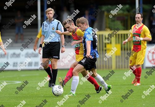 2013-09-01 / Voetbal / seizoen 2013-2014 / Rupel-Boom - Bornem / Arne Ivens (Bornem) met Jonas Laureys (r.)<br /><br />Foto: Mpics.be