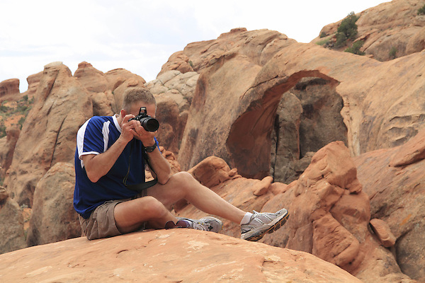 Photographer and Double-O Arch, Arches National Park, UT.<br />