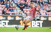 Picture by Allan McKenzie/SWpix.com - 13/07/2017 - Rugby League - Betfred Super League - Wigan Warriors v Warrington Wolves - DW Stadium, Wigan, England - George Williams kicks a conversion.