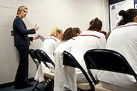 NORFOLK, VA--Assistant Coach Kate Paye talks to her team at hafltime during play against West Virginia University at the Ted Constant Convocation Center at Old Dominion University for the second round of the 2012 NCAA Championships. The Cardinal advanced to the West Regionals in Fresno with a score of 72-55.