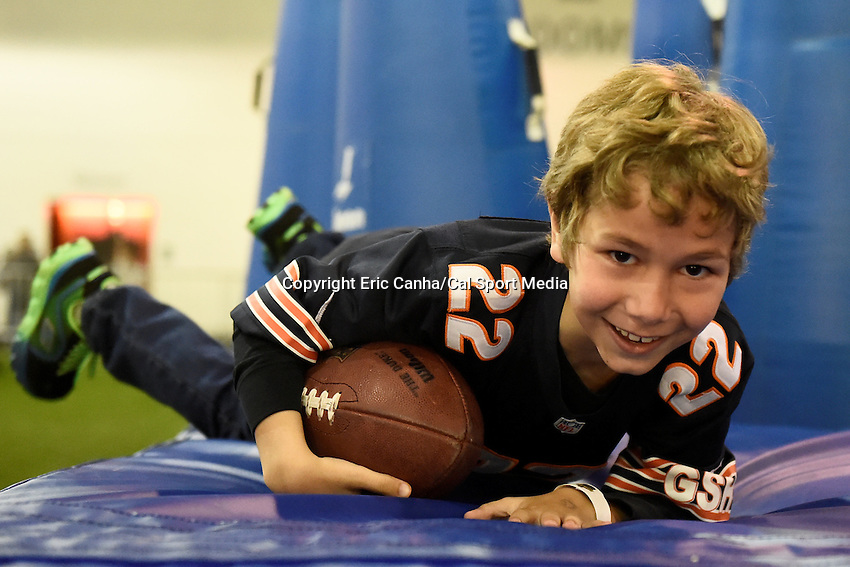 Sunday, January 31, 2016: A young fan breaks through a wall of tackle dummies at the NFL Fan Experience during the week long NFL Super Bowl 50 celebration  in San Francisco, California. Eric Canha/CSM