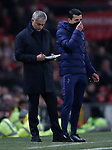 Tottenham Hotspur's Manager Jose Mourinho (L) takes notes during the Premier League match at Old Trafford, Manchester. Picture date: 4th December 2019. Picture credit should read: Darren Staples/Sportimage