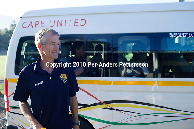 CAPE TOWN, SOUTH AFRICA - APRIL 8: Roald Poulsen, a Danish soccer coach, sends his soccer players off after a training session on April 8, 2010, in Cape Town, South Africa. Mr. Poulsen is the technical director for Cape United, a soccer academy for talented players from Africa and abroad. The school aims to develop their soccer skills, life skills and ultimately to place the most talented with professional soccer clubs around the world. The boys are mentored by players from the English Premiership and around 30 players a year are accepted. Cape United is the first African soccer development base for sourcing, developing and placing talent. (Photo by Per-Anders Pettersson/Getty Images)