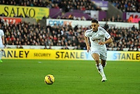 SWANSEA, WALES - JANUARY 17:   of  during the Barclays Premier League match between Swansea City and Chelsea at Liberty Stadium on January 17, 2015 in Swansea, Wales.<br /> <br /> Swansea's Neil Taylor on the ball