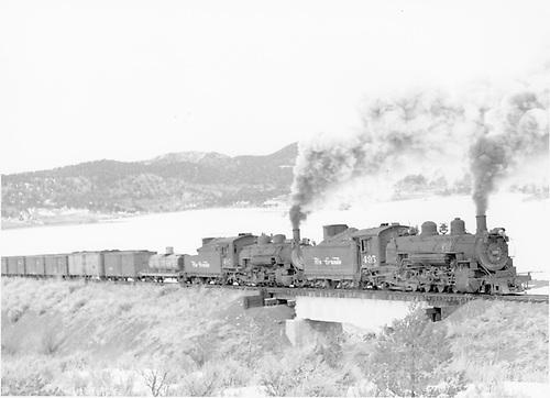 Eastbound freight with K-37 #495 (helper) and K-36 #487 (road engine) upgrade, crossing deck girder bridge.<br /> D&amp;RGW  Bocea, CO  Taken by Richardson, Robert W. - 2/1953