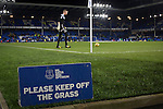 Everton 0 West Bromwich Albion 0, 19/01/2015. Goodison Park, Premier League. A sign warning people to keep off the pitch as players warm up at Goodison Park, Liverpool before the Premier League match between Everton and West Bromwich Albion. The match ended in a 0-0 draw, despite the home team missing a first-half penalty by Kevin Mirallas. The game was watched by 34,739 spectators and left both teams languishing near the relegation zone. Photo by Colin McPherson.