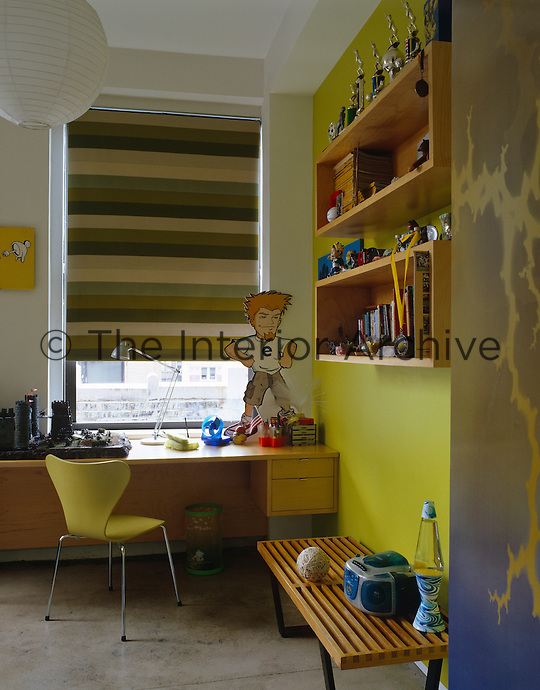 A built-in desk for homework and wall-mounted storage units ensure that there is room to play in this child's bedroom