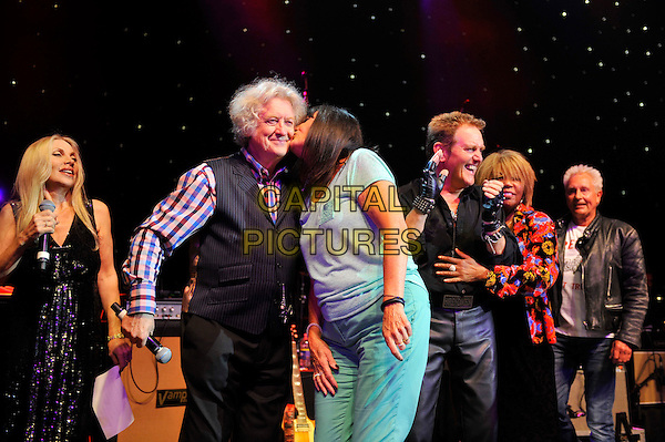 Singer / songwriter Lynsey De Paul has died at the age 64 following suspected brain haemorrhage. She represented the UK in the 1977 Eurovision Song Contest and was best known for her hits Sugar Me and Won't Somebody Dance With Me.<br /> STOCK PHOTO: Lynsey de paul, Noddy Holder, Sandy Shaw, Alvin Stardust, Linda Lewis and Andy Ellison<br /> performing for Marc Bolan's 35th anniversary concert in aid of the PRS for Music Members Benevolent Fund, Shepherd's Bush Empire, London, England. <br /> 15th September 2012<br /> on stage in concert live gig performance performing music half length black waistcoat singing check shirt kiss kissing <br /> CAP/MAR<br /> &copy; Martin Harris/Capital Pictures