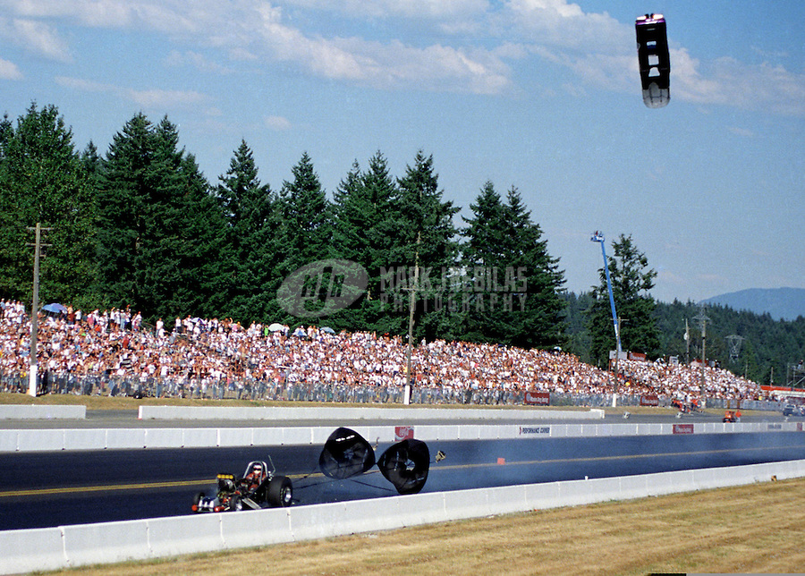 Aug. 4, 1997; Kent, WA, USA; NHRA top alcohol funny car driver Larry Miner blows the body off his car in the final round of the Northwest Nationals at Seattle International Raceway. (Editors note: Image 3 of 8 photo sequence) Mandatory Credit: Mark J. Rebilas-