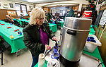 TORRINGTON,  CT-122519JS04- Peggy Scholl of Torrington, who also helps out at the Torrington Soup Kitchen, pours herself a cup of coffee as she and other guests wait for the annual Christmas Day dinner to be served at the kitchen on Wednesday.<br /> Jim Shannon Republican-American