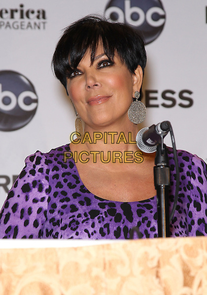 Kris Jenner.2012 Miss America Judges Press Conference at the Planet Hollywood Resort Hotel and Casino, Las Vegas, Nevada, USA..January 11th, 2012 .headshot portrait black purple leopard print microphone silver circle earrings.CAP/ADM/MJT.© MJT/AdMedia/Capital Pictures.