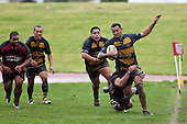 Edward Holmes tries to avoid being tackled over the sideline as he brings the ball out of the Bombay 22. Counties Manukau Premier Club Rugby game between Papakura & Bombay played at Massey Park Papakura on Saturday May 30th 2009..Bombay won 57 - 7 after leading 24 - 0 at halftime.