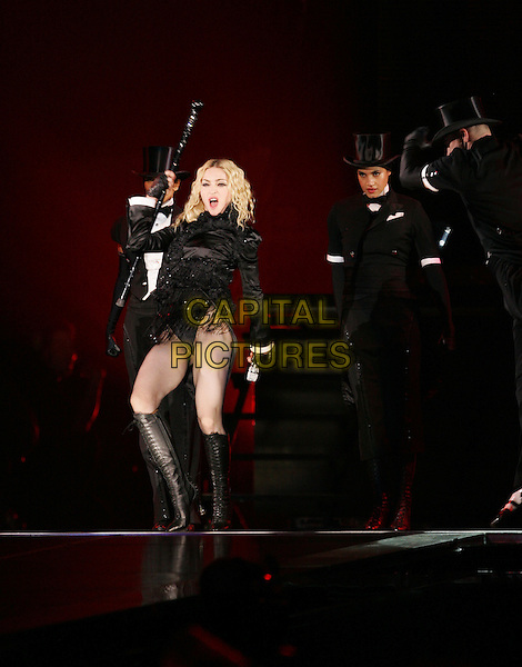 "MADONNA.Live at the ""Sticky & Sweet Tour"" held at Dodger Stadium in Los Angeles, California, USA. .November 6th, 2008                                                                     .stage concert gig performance music full length black sheer boots dancers .CAP/DVS.©Debbie VanStory/Capital Pictures."