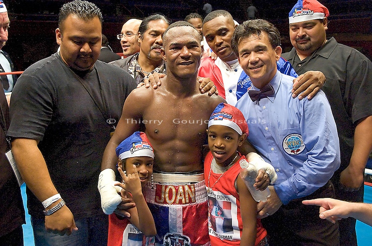 Joan Guzman  with family and friends after his  WBO Featherweight Eliminator Fight against Terdsak Jandaeng at the Westchester County Center, White Plains, NY on 08.26.2005..Guzman won by unanimous decision.
