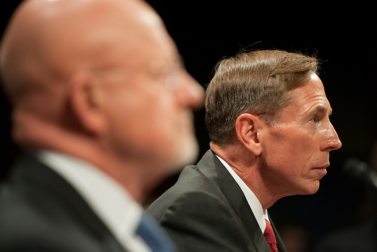 """UNITED STATES - SEPTEMBER 13:  David Petraeus, right, director of the Central Intelligence Agency, and James Clapper, director of National Intelligence, prepare to testify before a House Select Intelligence Committee and Senate Select Intelligence Committee joint hearing in the Capitol Visitor Center entitled """"The State of Intelligence Reform 10 Years After 9/11.""""  (Photo By Tom Williams/Roll Call)"""