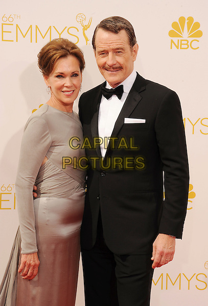 LOS ANGELES, CA- AUGUST 25: Actor Bryan Cranston (R) and Robin Dearden arrive at the 66th Annual Primetime Emmy Awards at Nokia Theatre L.A. Live on August 25, 2014 in Los Angeles, California.<br /> CAP/ROT/TM<br /> &copy;Tony Michaels/Roth Stock/Capital Pictures