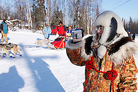 Saturday  March 13 , 2010   Rookie Middie Johnson of Unalakleet goes to park his team as his wife, Anausuk takes video footage of him at the Galena checkpoint .