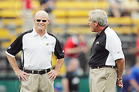 July 12, 2008; Hamilton, ON, CAN; Hamilton Tiger-Cats special teams coordinator Dave Easley and receivers coach Dennis Goldman prior to the CFL football game against the Saskatchewan Roughriders at Ivor Wynne Stadium. The Roughriders defeated the Tiger-Cats 33-28. Mandatory Credit: Ron Scheffler.