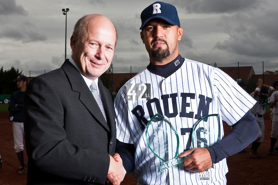 10 october 2009: Keino Perez of Rouen poses next to Denis Didier Rousseau, President of the French Baseball Federation, with the MVP trophy of the 2009 championship finals and the Best Pitcher award after game 4 of the 2009 French Elite Finals won 7-2 by Huskies of Rouen over Lions of Savigny, at Stade Jean Moulin stadium in Savigny sur Orge, near Paris, France. Rouen wins the 2009 France championship, his sixth title.