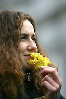 Una donna odora mimose durante la manifestazione indetta da Cgil, Cisl e Uil a Roma, 8 marzo, 2008, per il centenario della giornata internazionale della donna..A woman  smells mimosasduring a demonstration promoted by the italian Cgil, Cisl and Uil trade unions in Rome, 8 march 2008, for the hundredth anniversary of the International Woman Day..UPDATE IMAGES PRESS/Riccardo De Luca