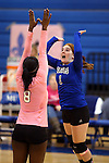 Marymount's Morgan McAlpin and Cassidie Watson get ready for a college volleyball match against Shenandoah at Marymount University in Arlington, Vir., on Tuesday, Oct. 8, 2013.<br /> Photo by Cathleen Allison