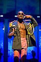 "London, UK. 21/07/2011.  ""FELA!"" opens at Sadler's Wells. FELA! is a provocative hybrid of dance, theatre and music exploring the extravagant world of Afrobeat legend Fela Kuti. Sahr Ngaujah as Fela. Photo credit : Jane Hobson"