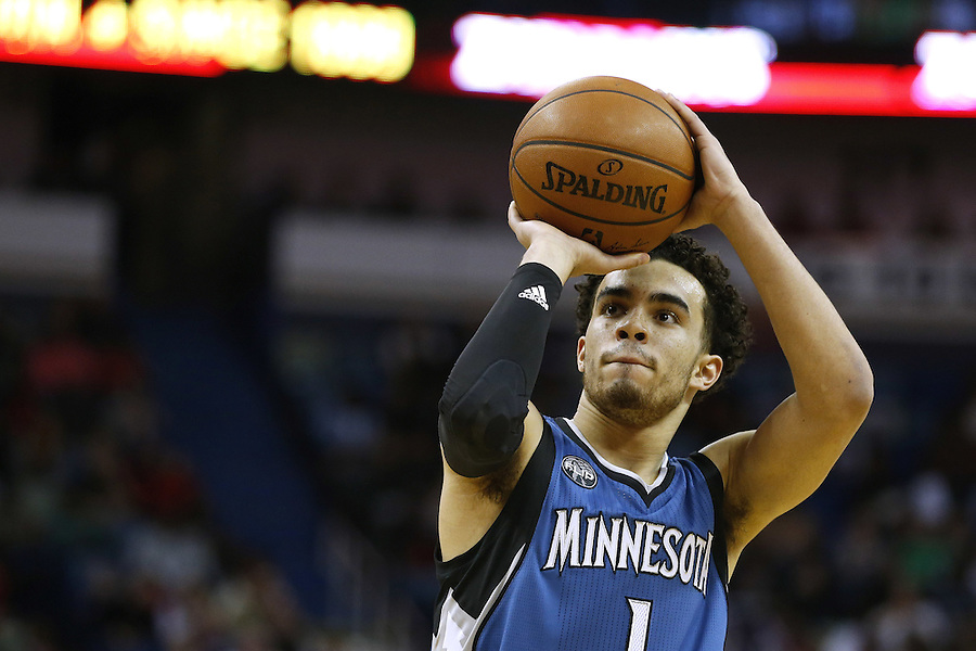 Minnesota Timberwolves guard Tyus Jones (1) shoots the ball during the second half of an NBA basketball game Saturday, Feb. 27, 2016, in New Orleans. The Timberwolves won 112-110. (AP Photo/Jonathan Bachman)