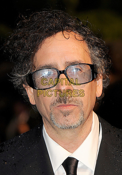 TIM BURTON .Royal World Film Premiere of 'Alice in Wonderland' at the Odeon cinema, Leicester Square, London, England, UK, 25th February 2010 .arrivals portrait headshot glasses tinted black tie goatee facial hair beard .CAP/BEL.©Tom Belcher/Capital Pictures.