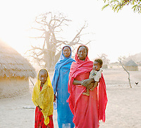 Mothers and their children, members of the Nuba tribe, in the village of Nyaro, Kordofan Region, Sudan
