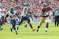Landover, MD - November 18, 2018: Washington Redskins running back Adrian Peterson (26) runs for a touchdown during the  game between Houston Texans and Washington Redskins at FedEx Field in Landover, MD.   (Photo by Elliott Brown/Media Images International)