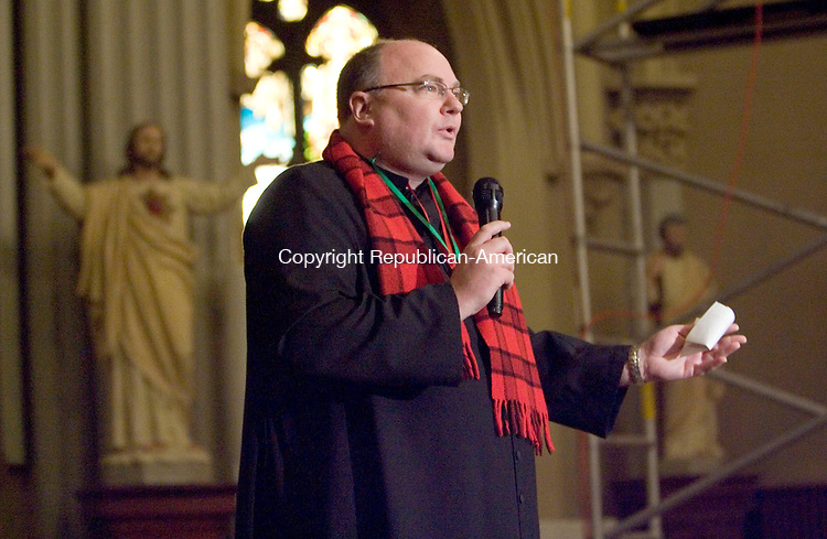 WATERBURY, CT- 06 JAN 2008- 010608JT07-<br /> The Rev. Michael Hinckley begins the third annual Boar's Head Festival on the altar of the Shrine of Saint Anne in Waterbury on Sunday. <br /> Josalee Thrift / Republican-American