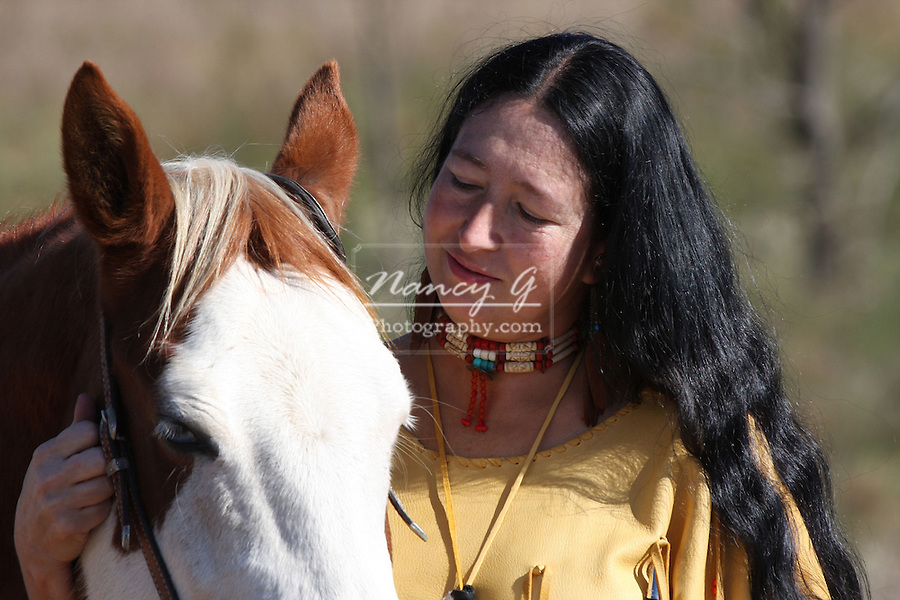 A Native American Indian woman with her horse