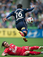 MELBOURNE, AUSTRALIA - JANUARY 09: Carlos Hernandez of the Victory evades a tackle by Francisco Usucar of United  during the round 22 A-League match between the Melbourne Victory and Adelaide United at AAMI Park on January 9, 2011 in Melbourne, Australia. (Photo by Sydney Low / Asterisk Images)