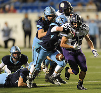 NWA Democrat-Gazette/ANDY SHUPE<br /> Luke Rapert (22) of Fayetteville has the ball knocked away by Noah Hayward (center) of Har-Ber Saturday, Dec. 5, 2015, during the second half of the Class 7A state championship game at War Memorial Stadium in Little Rock. Visit nwadg.com/photos to see more photographs from the game.