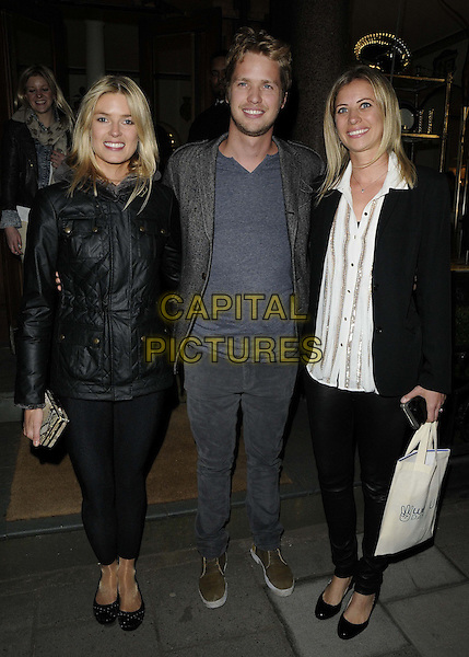 "Isabella Calthorpe, Sam Branson & Holly Branson.The ""We Day UK"" launch event, an active citizenship programme helping schools & youth groups to make a difference, Thomas Goode store, South Audley St., London, England..April 22nd, 2013.full length white shirt blazer leather black trousers pants jeans denim blue grey gray brother sister siblings family couple leggings .CAP/CAN.©Can Nguyen/Capital Pictures."
