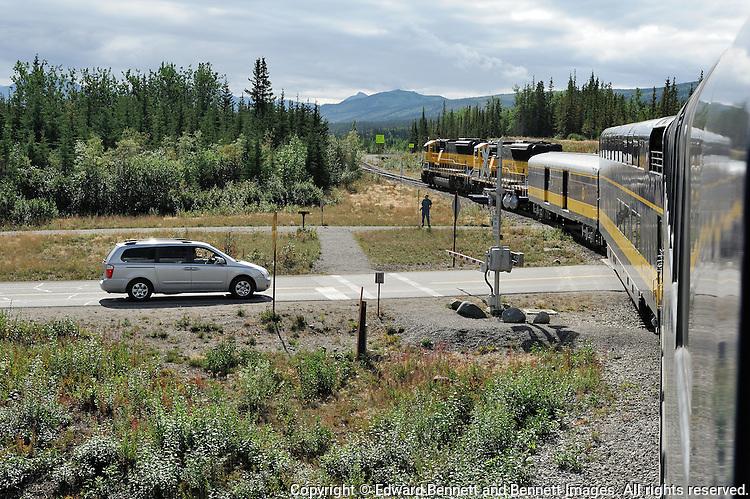 The Alaska Railroad's Denali Star train crosses the Denali Park road as it nears the Denali Depot.