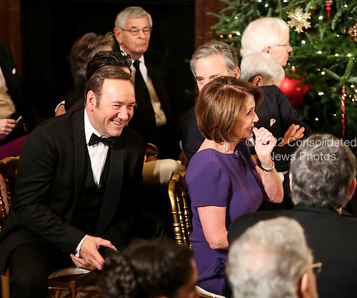 Actor Kevin Spacey, left, and United States House Minority Leader Nancy Pelosi (Democrat of California), right, wait for the beginning of an event for the 2016 Kennedy Center Honorees, in the East Room of the White House, December 4, 2016. The 2016 honorees are: Argentine pianist Martha Argerich; rock band the Eagles; screen and stage actor Al Pacino; gospel and blues singer Mavis Staples; and musician James Taylor.<br /> Credit: Aude Guerrucci / Pool via CNP